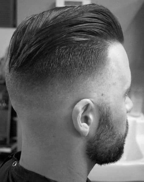 Faded Undercut Slicked Back Guys Haircut