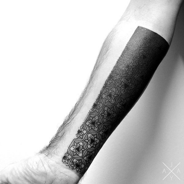 Fading Black Pattern Tattoo Male Forearms