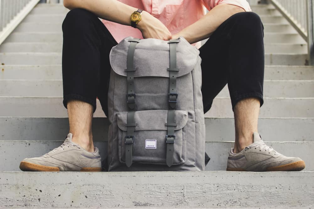young traveler man with modern and fashionable backpack