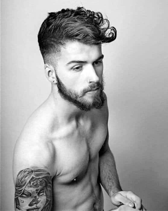 Fashionable Medium Curly Haircut For Males With Low Fade On Sides