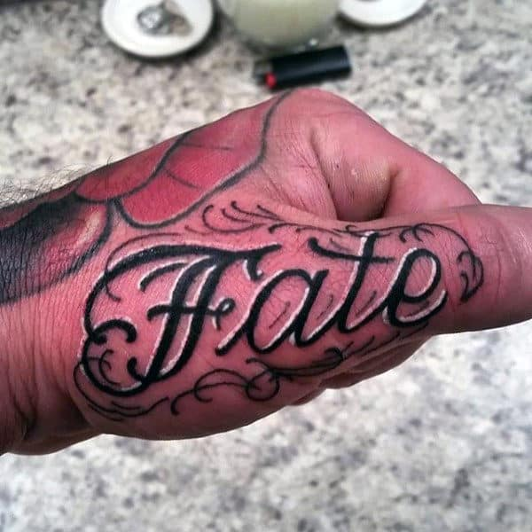 Fate Lettering Black And White Ink Thumb Tattoos On Man