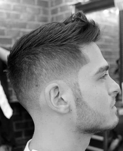 Faux Hawk Mens Short Hairstyle With Taper Fade On Sides