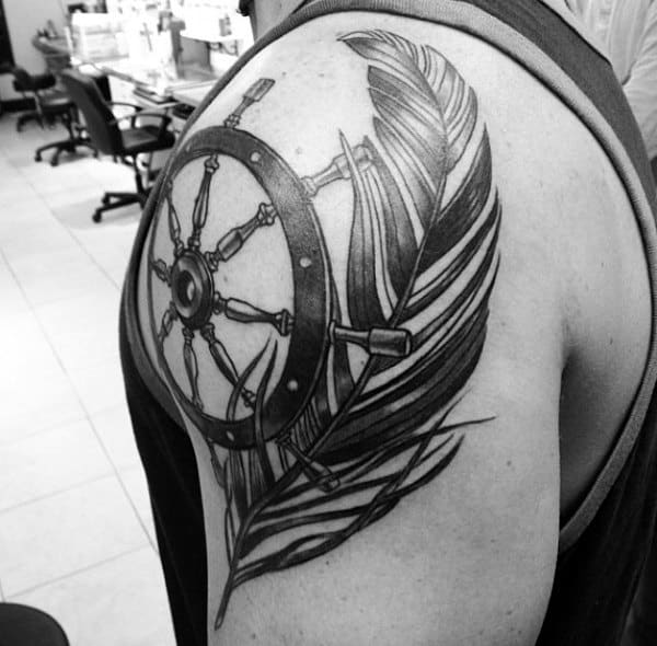 Feather And Ship Wheel Black Ink Tattoo For Males On Shoulder