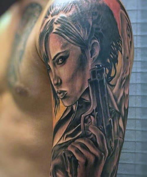 Female Men's Tattoo Gun On Upper Arm