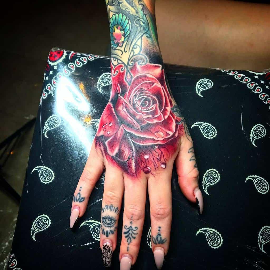 female rose hand tattoos johnnazariotattooer
