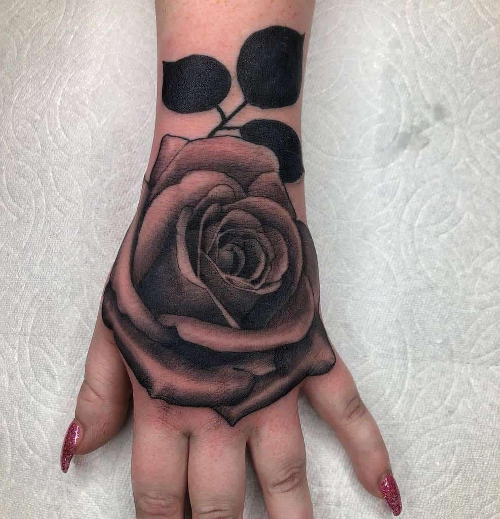 female rose hand tattoos tonyraztattoo