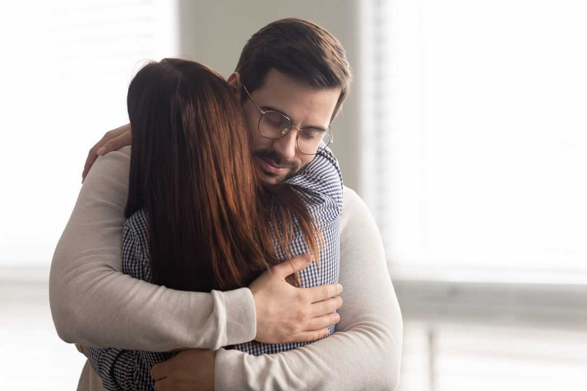 Handsome,Man,Embracing,Woman,Calms,In,Difficult,Moment.,Husband,Hugging
