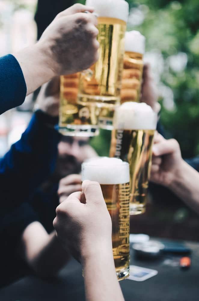 five filled beer mug with beer