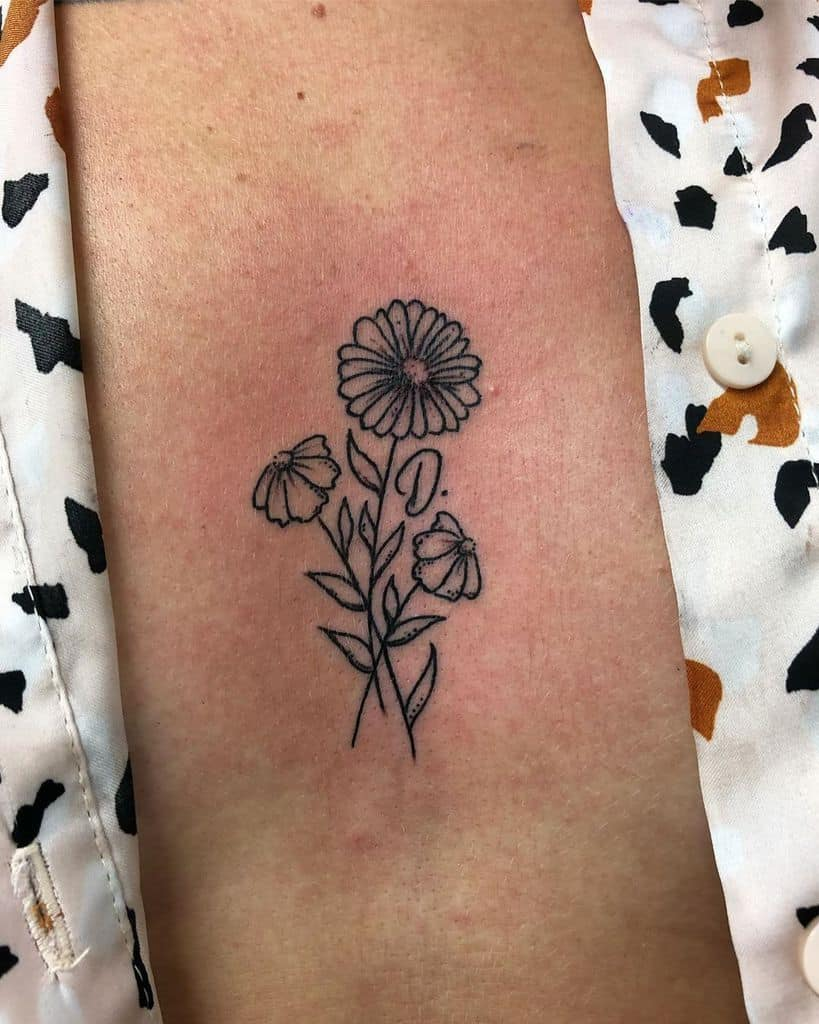 Sternum tattoo black and grey fine line daisy bouquet