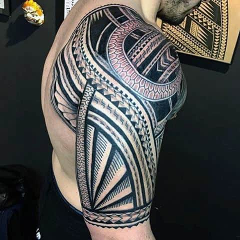 Finely Detailed Male Tribal Shoulder And Half Sleeve Tattoos