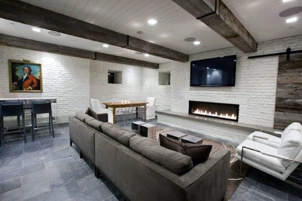 Finished Rustic Basement Ideas With White Painted Brick And Vintage Wood Beams