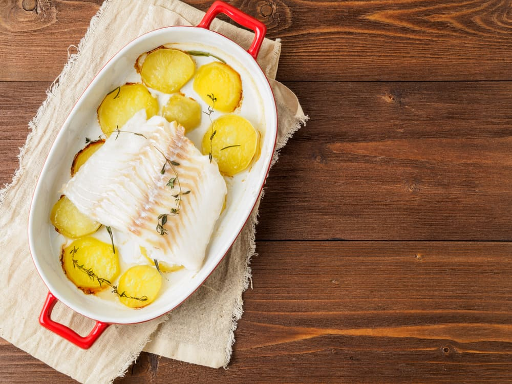 fish cod baked in the oven with potatoes and spice and thyme