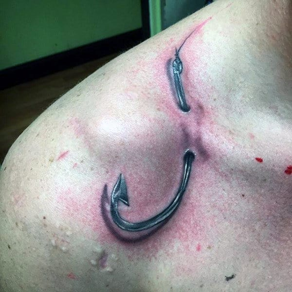 Fishing Hook Poking Through Skin Mens Shoulder Tattoo Realistic