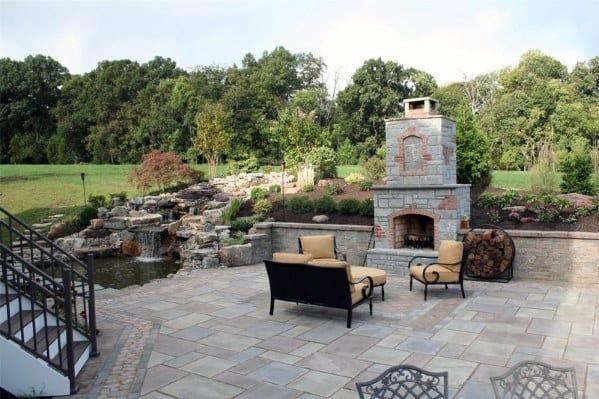 Flagstone Patio Home Designs With Backyard Stone Fireplace
