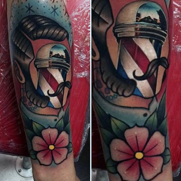 Floral Barber Tattoo Of Man With Pole For Face In Color Ink