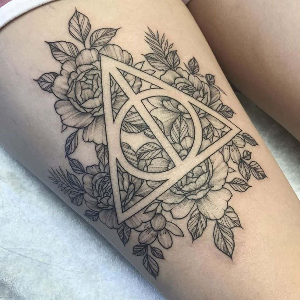floral harry potter deathly hallows fine line tattoo