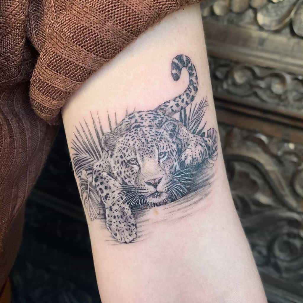 floral-inked-fine-line-palm-leaf-jaguar-tattoo-lozzarachtattooer