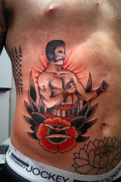 Flower With Traditional Boxer Guys Lower Chest Ribs Tattoo