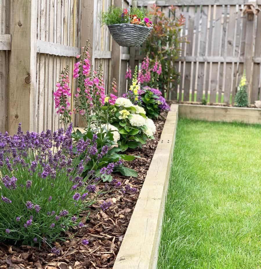 flowerbed along the fence flower bed ideas milgarthhome