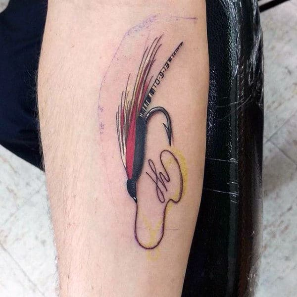 Fly Fishing Hook Tattoo On Mans Arm