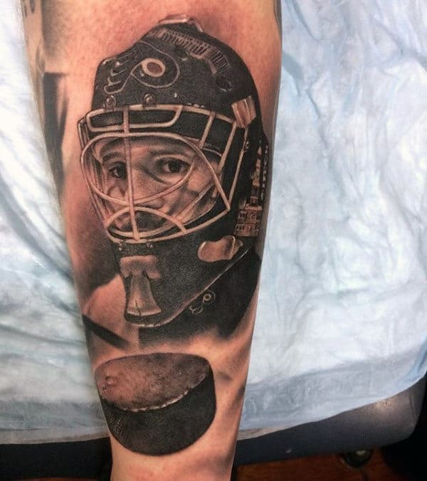 Flying Puck With Hockey Player Guys Forearm Tattoos