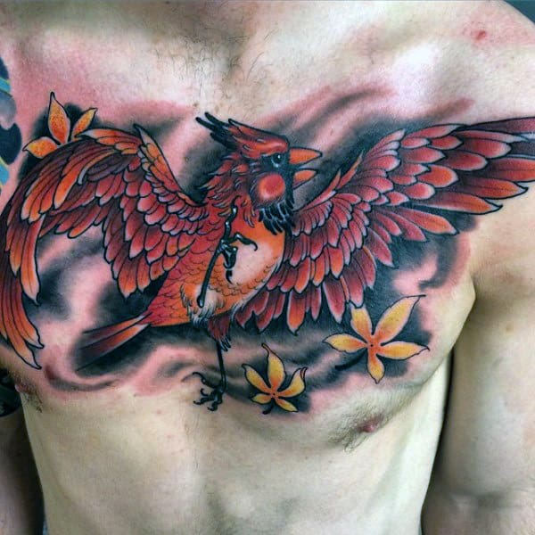 Flying Red Cardinal Bird With Yellow Leaves Blowing In The Wind Mens Chest Tattoo