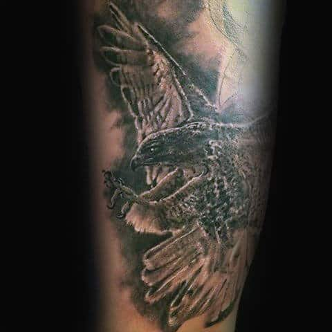 Flying Shaded Grey And Black Falcon Arm Tattoo On Gentleman