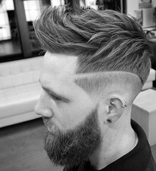 Fohawk Skin Fade Haircut For Men With Wavy Thick Hair