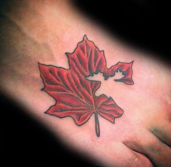 Foot Tattoo On Man Of Maple Leaf With Negative Space Moose Design