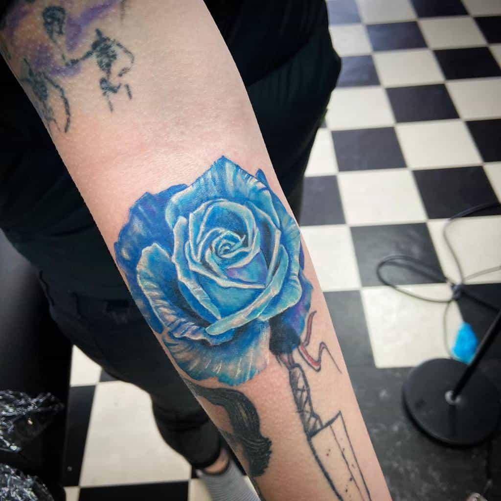 forearm blue rose tattoos drquinlin