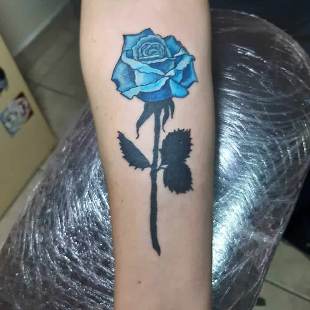 forearm blue rose tattoos goranzutitattoo
