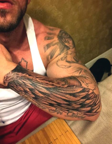 Forearm Mens Wing Tattoo In Black Ink