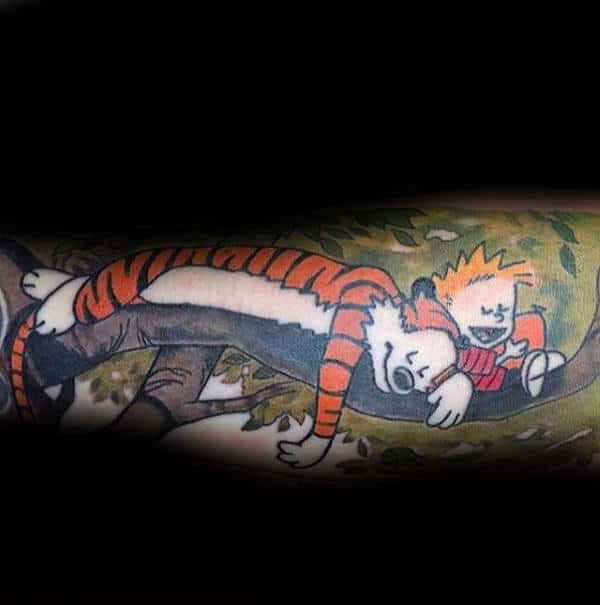 Forearm Sleeve Mens Tattoo Of Calvin And Hobbes Sleeping On Tree Branch