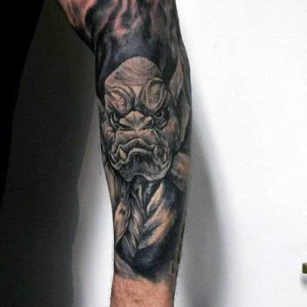 Forearm Sleeve Tattoo Of Gargoyle On Man