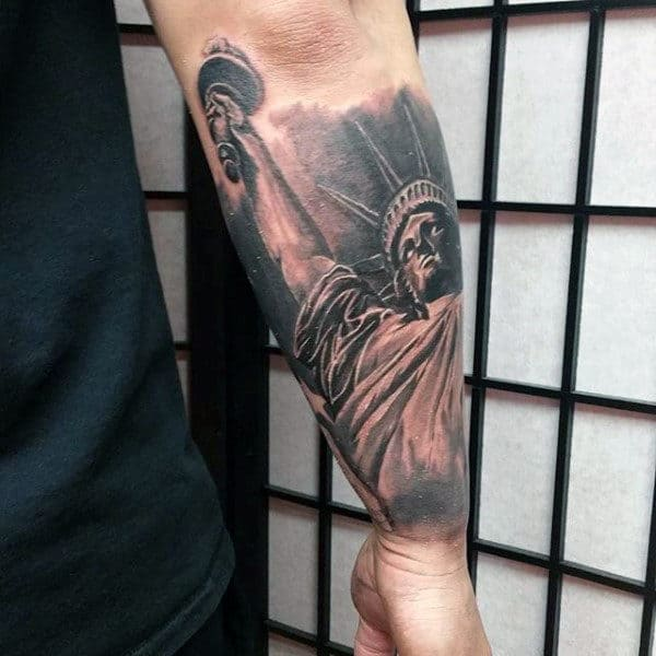 Forearm Sleeve Tattoo Of Patriotic Statue Of Liberty With Shaded Ink