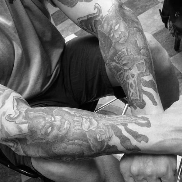 Forearm Tattoos Of Gargoyles On Man
