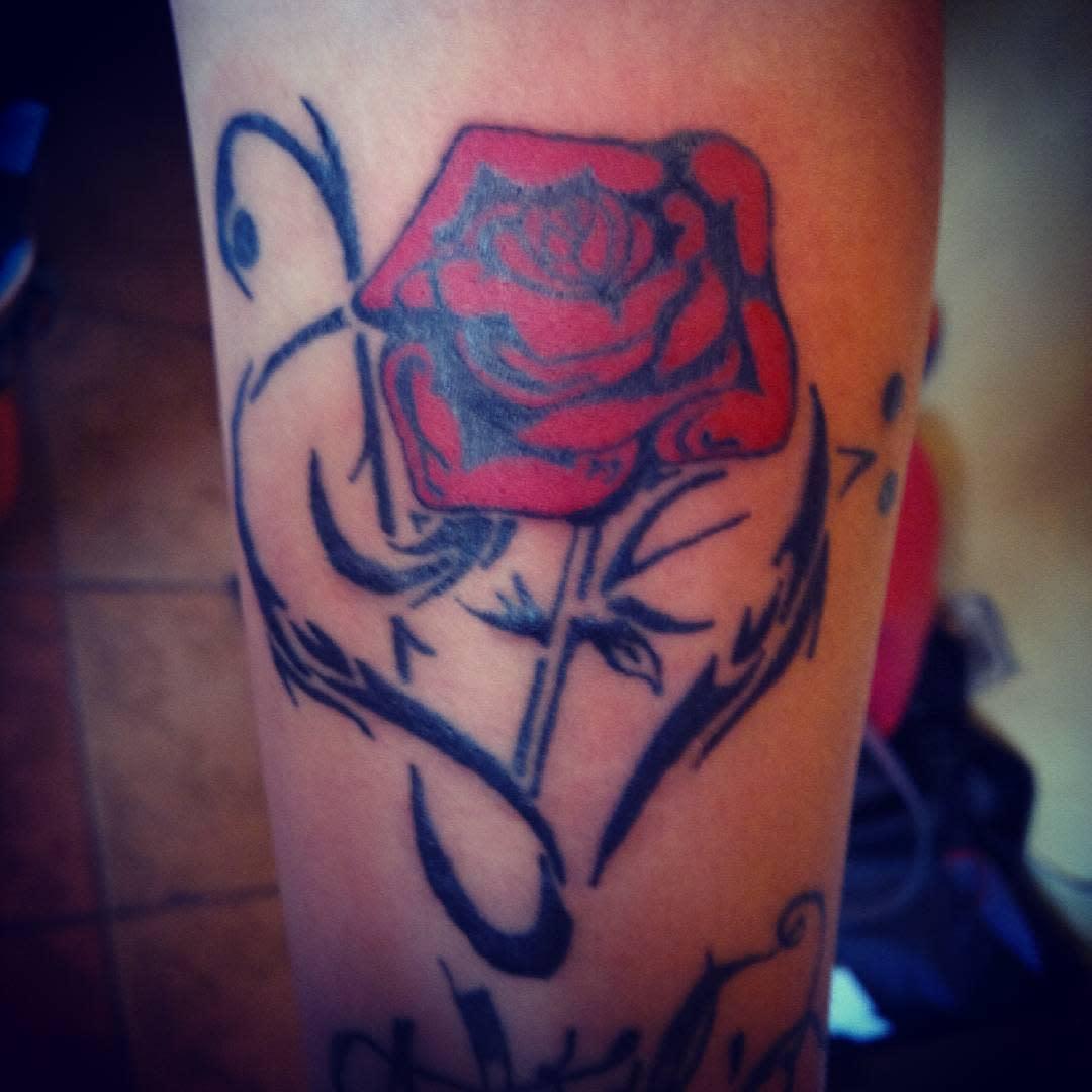forearm tribal rose tattoos rebelliontattoos1