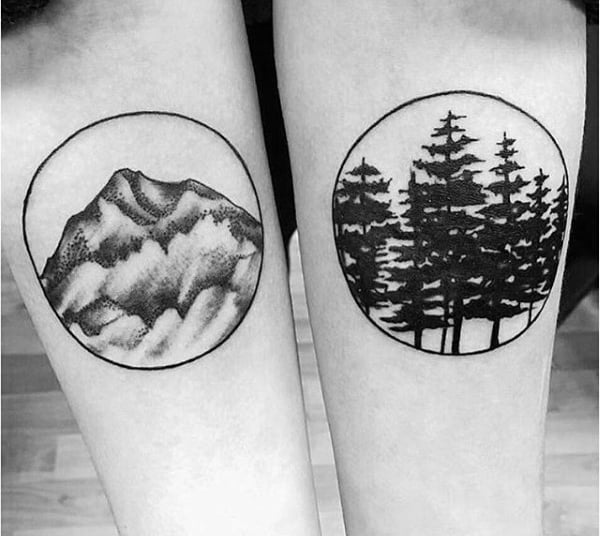 Forest And Mountain Circle Tattoos On Mans Inner Arms