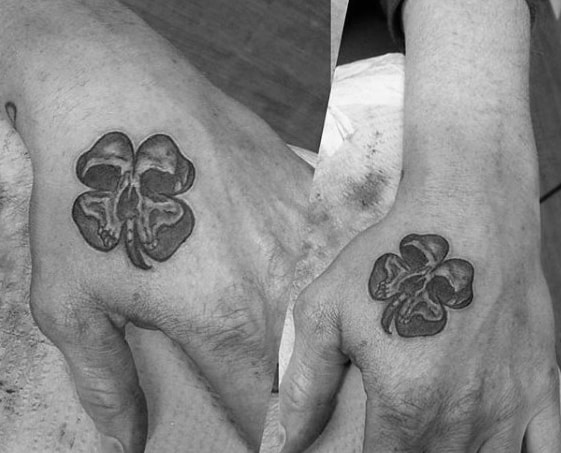 Four Leaf Clover Skull Male Small Hand Tattoo