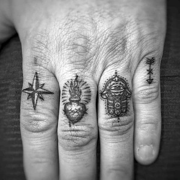 four-symbols-on-mans-hand-finger-tattoos