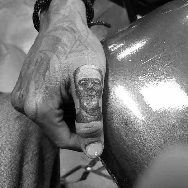Frankenstien Thumb Tattoos For Men
