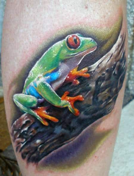 Frog On Wood Branch Mens Leg Tattoos