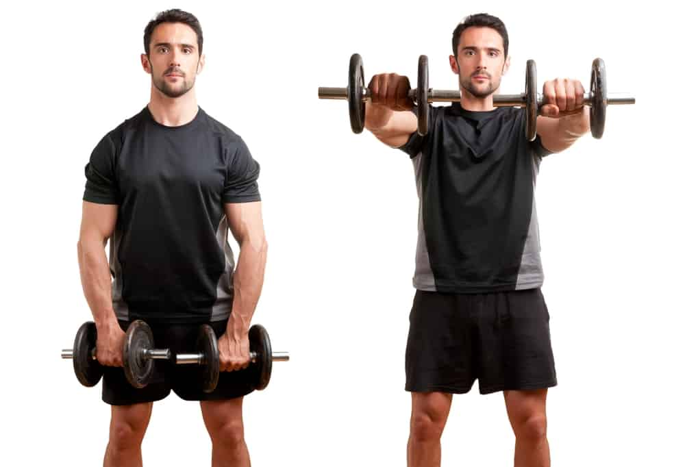 personal trainer doing front dumbell raises for training his deltoids