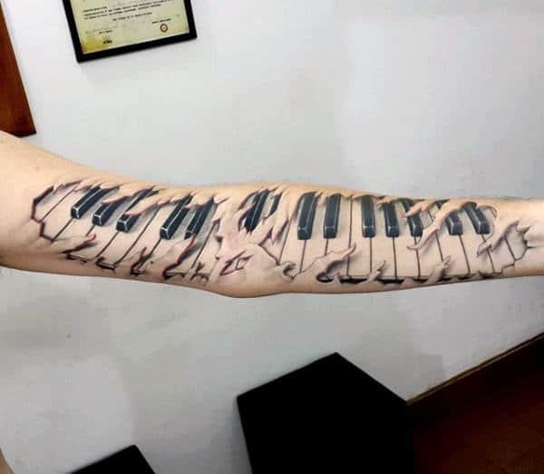 Full Arm Male Ripped Skin Piano Tattoo Ideas