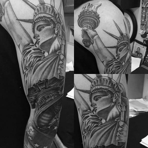 Full Arm Male Tattoo Of Patriotic Statue Of Liberty With Bell