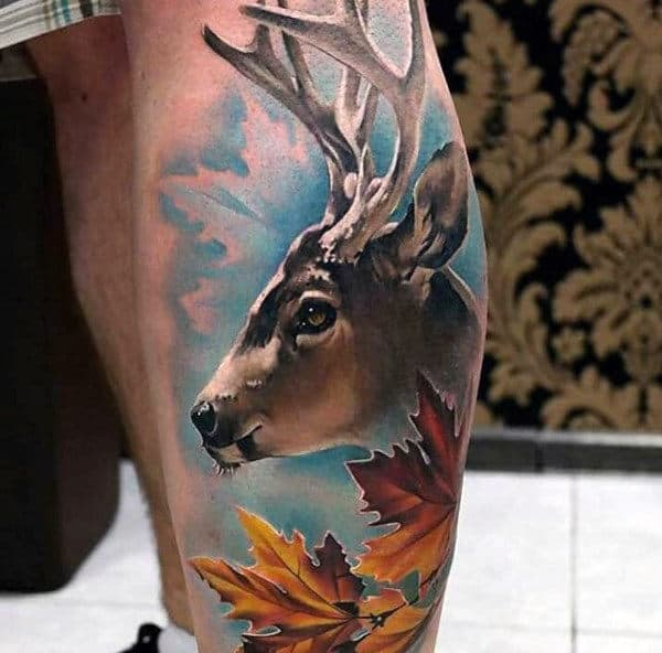 Full Color Mens Leg Calf Deer Tattoo With Blue Sky And Orange Leaves