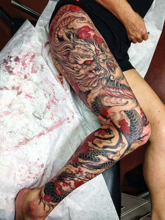 Full Leg Black And Red Japanese Dragon Mens Sleeve Tattoos