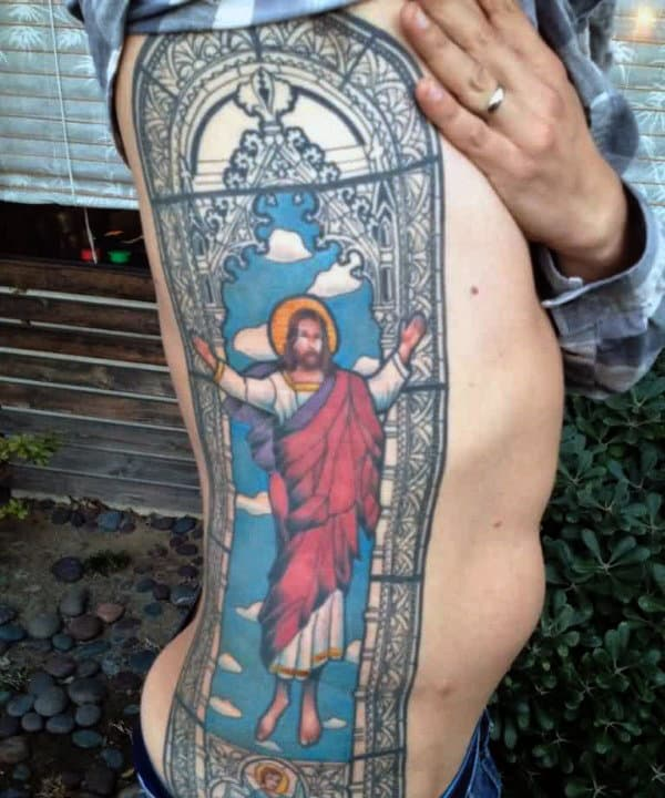 Full Rib Cage Side Stained Glass Tattoo On Male Of Jesus