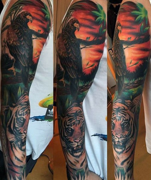 Full Sleeve Hawk Watches Crouching Tiger At Sunset Tattoo On Gentleman