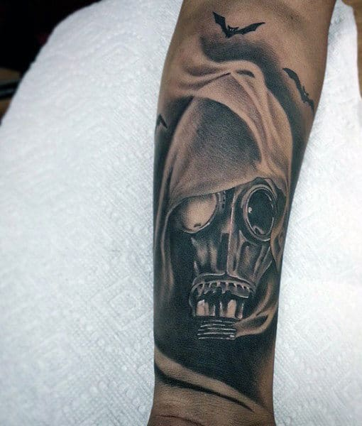 Fuming Male Gas Mask Tattoo On Forearm